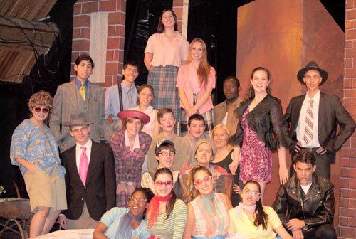 "The cast of the Idyllwild Arts production of ""Little Shop of Horrors."" Front row (from left) are Ashley Arnold, Grace Haggard, McCailey Contreras and Claire Frisinger. Second row (from left) are Lincoln Belford, Rosanna Lindmarker, Delaney Spangler and Dakota Shapiro. Third row (from left) are Hannah Osgood-McAuliff, Nicolas Amatullo, Roxanne Semans, Travis Flynt, Alina Pontius and Zen Ocean. Fourth row (from left) are Chad Jones, Christian Torrez, Celeste Oliva, Galen Patterson, Sofie Puchley and Javen Crosby.  Photo by J.P. Crumrine"
