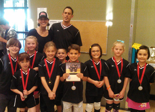 Second-place winners in Division A were the Black Panthers. Shown at top are Coaches Dawn and Jason Sonnier; middle row, from left, Zach Russo, Bailey Easley and Brody Posey; and bottom row, from left, Kendra Collis, Claudia DeLucien, Colby Sonnier, Alyssa Holland, Lilyan Easley and Bethany Holland.    Photo by Ginger Dagnall