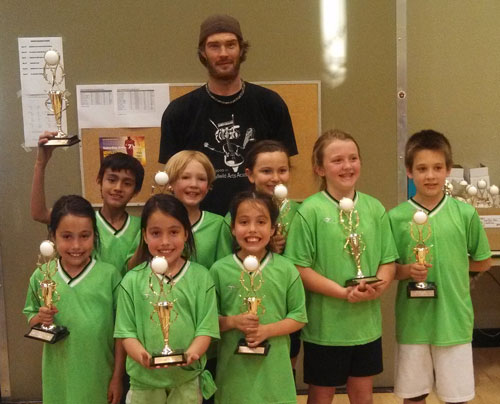 First-place winners in Division A in Town Hall Kids Volleyball last week were the Green Dragons. Back row is Coach Jeremy Teegarden; middle row, from left, Fernando Maldonado, Layton Teegarden, Serena Rodriguez, Lauren Johnson and Adein McLean; bottom row, from left, Lorelei Nowell, Josslyn Nowell and Calista Nowell. (Not shown was Tara Geisinger.)   Photo by Ginger Dagnall