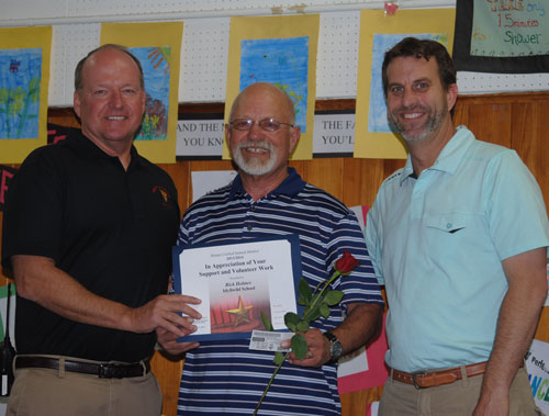 """Rick Holmes (center) was recognized as Idyllwild School Volunteer of the Year at Friday's Volunteer Reception. Idyllwild School Principal Matt Kraemer (left) and fourth-grade teacher Tom Dillon (right) honored Holmes' contributions throughout the year. """"He just shows up. He has one focus — helping kids. He's equal with me,"""" Dillon said, describing Holmes efforts.  Photo by J.P. Crumrine"""