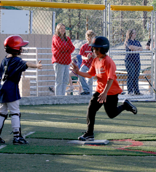 Giants' Colby Sonnier crosses the plate after hitting his first of two homeruns in the June 11 Town Hall minor league game against the Braves at Idyllwild School field. The Giants won 6-5.     Photo by Jack Clark