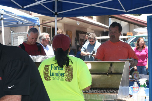 FREE LUNCH: Forest Lumber hosted its annual Customer Appreciation Barbecue midday Thursday, offering free lunch.       Photo by Jay Pentrack