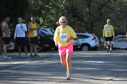 Dora Dillman leads the female walkers in the Idyllwild 5k Fitness Walk.  Photo by Brennen Priefer