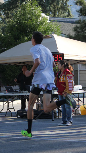 Jayden Emerson, of Idyllwild, was the first runner across the finish line in the 5k Race (3.1 miles). Jayden finished in 16:18 minutes, setting a course record. The previous best time was Jeff Ambrose who crossed the finish line at 16:28. Photo by  Brennen Priefer