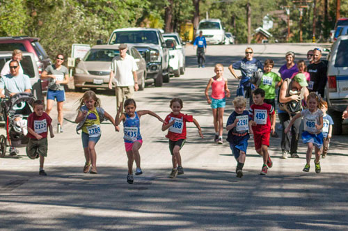 LITTLE LEGS TAKE OFF: Mia Sharp leads the pack in the Kids Fun Run portion of the Idyllwild 5k and 10k races. The kids start in front of Town Hall and run a half-mile around the block. For more race photos and the results, see page 10. Photo by John Pacheco