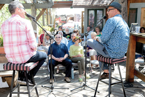 Author Ben Loory (left) and Eduardo Santiago speakSunday at the Idyllwild Author Seriesas the audience listens at Cafe Aroma. Photo by Jenny Kirchner