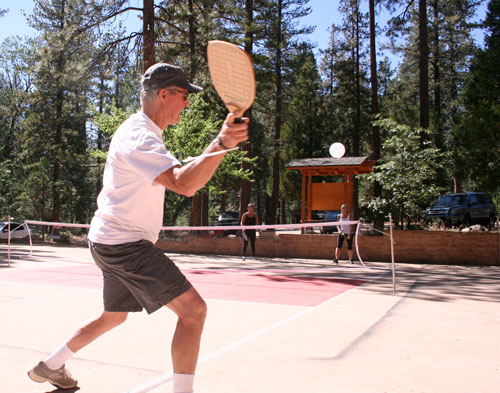 Pickleball is one of the fastest growing sports in America played by people of all ages and athletic abilities. Take note of the painted courts at the Idyllwild Community Center site where the sport of pickleball is now being introduced. Everyone is invited to learn and experience the fun of pickleball from 10 a.m. to noon Saturday, June 21, or from 2 to 4 p.m. Sunday, June 22. Long-time player and pickleball teacher Barry Wallace (above, with Becca and Cindy Luna behind the net) is offering the free clinics. Paddles and balls are provided. For more information, call Wallace at (714) 721-0145.               Photo by Teresa Garcia-Lande