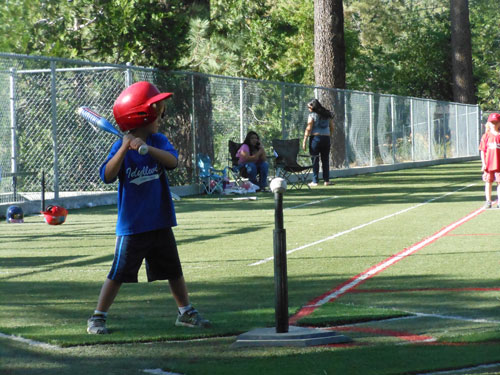Griffin Kretsinger is ready to put the ball in play Monday night when the Dodgers played the Angels in Town Hall T-ball.   Photo by Teresa Garcia-lande