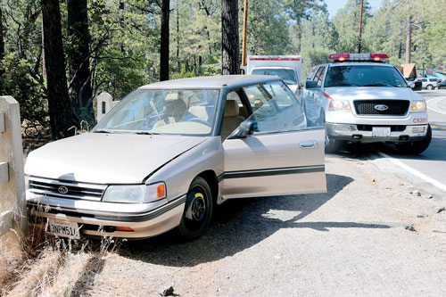 According to California Highway Patrol Officer Ron Esparza, Mitsuru Betty Kaminaka, 88, of Hemet, was driving her Subaru Legacy through Idyllwild, and was involved in two traffic incidents Thursday afternoon, June 19. Kaminaka's car struck Barbara Pongratz, 60, of Idyllwild, from behind while she was walking on the northbound side of North Circle Drive near River Road. Idyllwild Fire, and CHP responded to the hit-and-run, where the Legacy's passenger-side mirror was left at the scene. Pongratz was transported by ground to San Gorgonio Medical Center in Banning complaining of left side pain, including an abrasion and a possible broken leg. Within minutes, a second traffic collision call came into Idyllwild Fire and CHP. This involved a traffic collision with a tree on Highway 243 near the Riverside County Playground Road. This driver was Kaminaka, who crashed the Legacy into a tree and concrete fence around 3 p.m. When personnel arrived on scene, they matched Kaminaka's passenger-side mirror with her vehicle, confirming her vehicle was the same vehicle that struck Pongratz. Kaminaka was transported by ground to Kaiser Permanente Riverside Medical Center with unknown injuries. Pending further investigation, Kaminaka may be charged with felony hit-and-run. Photo by Jenny Kirchner