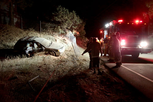 At right, McKenzie Smith, 21, of Idyllwild was traveling northbound on Highway 243 at about 12:45 a.m., Wednesday morning, June 18, when he lost control of his 2004 Subaru Outback, careening through a fence near Pine Cove Rd. Smith and his passengersAlden Rizor, 18 of Hemet, andBrandon Gross, 21 of Murrieta, were uninjured. According the California Highway Patrol Officer Ron Esparza, the cause of the crash was unsafe speeds, at approximately 50-60mph. Photo by Jenny Kirchner