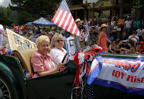 Carol Levitsky and Linda Turner drive in the Idyllwild Area Historical Society's caravan.   Photo by John Drake