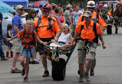 The Riverside Mountain Rescue Unit demonstrated its drills for the crowd during the 2014 Independence Day Parade in Idyllwild.  Photo by John Drake