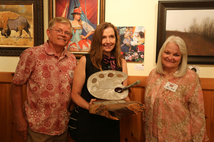 The Art Alliance of Idyllwild held a judged show this weekend. The Artist of the Year award is shared by two winners this year – Johnathan Wiltshire (left) and Gwen Novak (right). Molly Colman (middle) presents the award to the 2014 winners. Photo by Cheryl Basye