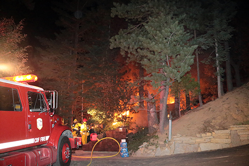 Riverside County Fire and Idyllwild Fire responded to a debris fire that caught nearby vegetation on fire in Fern Valley Tuesday night about 8:45 P.M. The fire was near 55591 Encino Dr. and was quickly brought under control. The cause is still under investigation. Photo by Jenny Kirchner