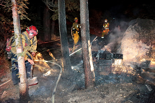 The fire was quickly extinguished Tuesday night after Riverside County Fire and Idyllwild Fire responded to a debris and vegetation fire in Fern Valley. Photo by Jenny Kirchner