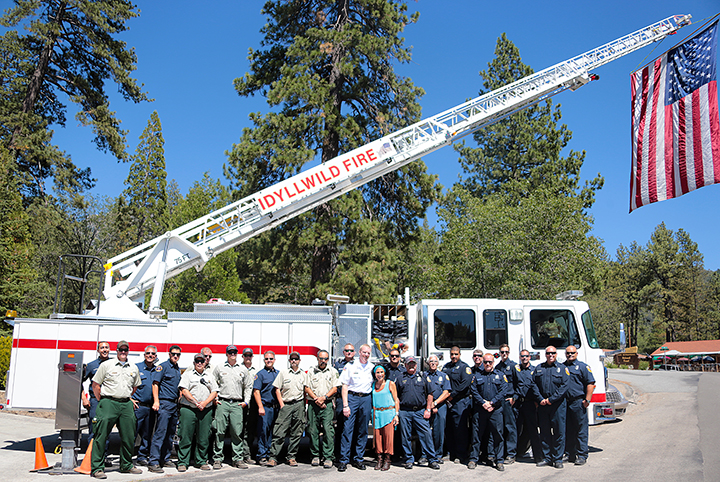 Idyllwild Fire, Cal Fire and the U.S. Forest Service pose in front of Truck 621 at the Idyllwild Fire Station Sunday afternoon during the one-year anniversary of the Mountain Fire. Photo by Jenny Kirchner