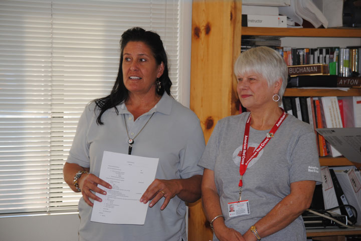 Michelle Aleman (left), disaster program coordinator for the American Red Cross of Orange, Riverside and San Bernardino counties, and Patricia Schnetzer, the Red Cross volunteer coordinator for Idyllwild's Mountain Disaster Preparedness group, spoke to a large gathering of volunteers at the Idyllwild Fire Station last week.  Photo by J P Crumrine
