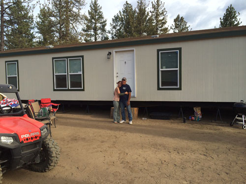 Sasha Fisher and Marty Prevosto stand in front of their new home in Bonita Vista.   Photo by Marshall Smith