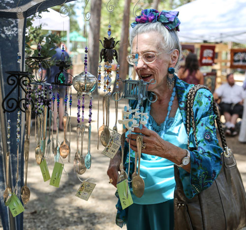 Alice Lindsey eyes the utensil chimes at the 2nd Saturday Art Fair held at the Idyllwild Community Center and sponsored by the Art Alliance of Idyllwild. Photo by Cheryl Basye