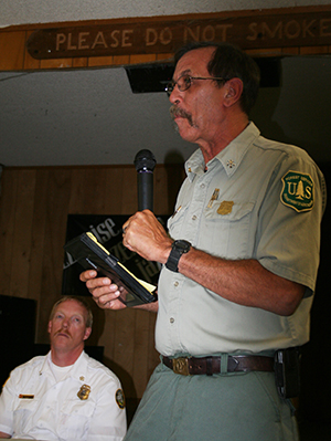 U.S. Forest Service Fire Chief Dan Felix explains upcoming projects and goals of his agency for the Hill. Idyllwild Fire Chief Patrick Reitz (sitting) also spoke about abatement and hardening houses. Photo by Becky Clark