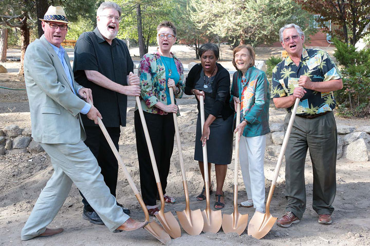 Bruce Ryan, Building and Grounds Committee chair; Bill Lowman, past Idyllwild Arts president;Faith Raiguel, immediate past board chair;Pamela Jordan, Idyllwild Arts president;Lillian Lovelace, Board of Governors andBuzz Holmes, campaign co-chair, pose for a photo and sing some songs Saturday during theGroundbreaking Celebration of the William M. Lowman Concert Hall.       Photo by Jenny Kirchner
