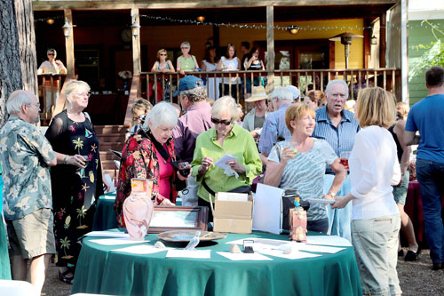 Many came out to socialize and support the Idyllwild Community Fund Saturday. Wine and beer tastings, appetizers, silent auction, raffle and live music were all part of the fundraiser at the Rainbow Inn.         Photo by Jenny Kirchner