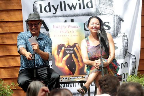 Eduardo Santiago, left, speaks with award-winning author Josefina López on Sunday at Cafe Aroma as part of the Idyllwild Authors Series.   Photo by Jenny Kirchner