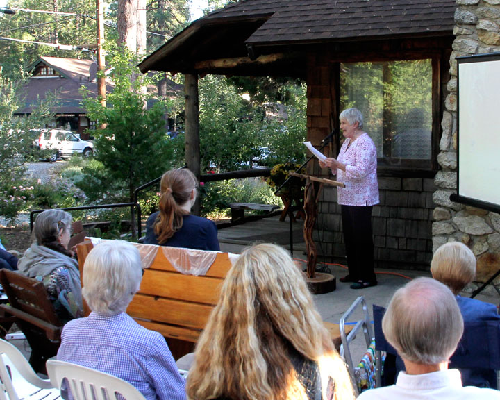 Many local residents shared their written memories of the 2013 Mountain Fire last Thursday evening at the Idyllwild Area Historical Society Museum. Here, Marilyn O'Connor tells the gathered of the personal passage she made during the fire and of facing crisis with good friends and Canadian Meatloaf. Photo by John Drake