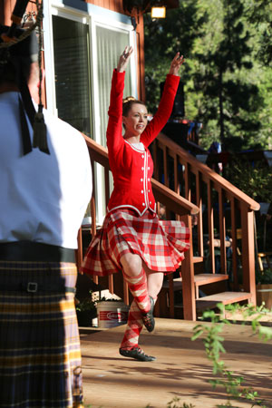 Jackie Weis dances during University of California, Riverside, Pipes in the Pines Band evening performance at Alpenglow Gardens on Independence Day eve. Photo by Cheryl Basye