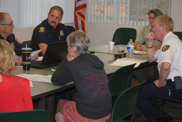 Members of Mountain Communities Fire Code Committee discussed fire abatement and enforcement during their first meeting. Riverside County Fire Chief John Hawkins (far left) established the committee. Other members, from his left, are Joe Lewis, Cal Fire, Battalion Chief  Richard Gearhart, U.S. Forest Service, and Idyllwild Fire Chief Patrick Reitz. With their backs to the camera are Edwina Scott, executive director of Mountain Communities Fire Safe Council and Sue Nash, an attorney and private citizen member of the committee.            Photo by J P Crumrine