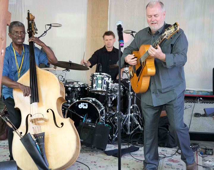 Marshall Hawkins (left) on bass, Jeff Olson on drums and Bob Boss on guitar perform during the annual Patrons Dinner at Idyllwild Arts Friday night. Ruby and the Red Hots also performed to a crowd that had a hard time staying off the dance floor. Photo by Jenny Kirchner