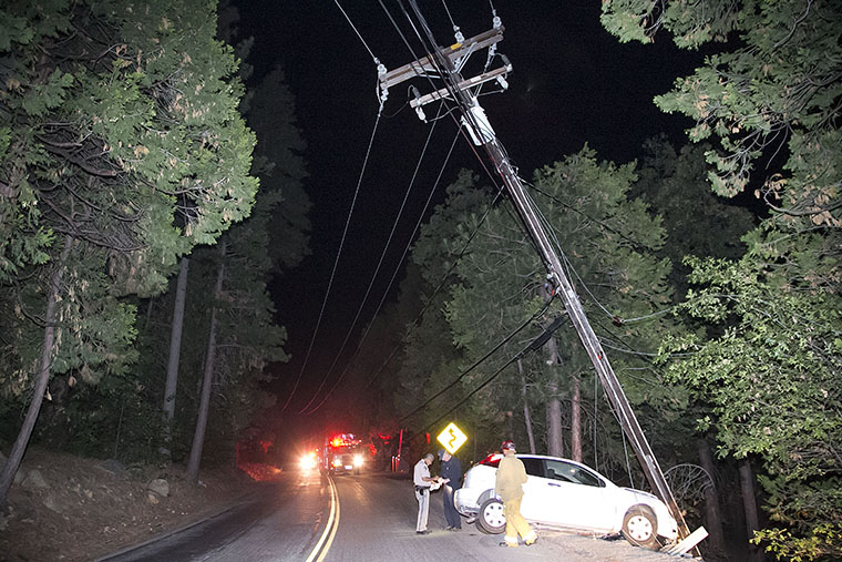 Yoichi Christopher Kido Jr., 32 of Idyllwild crashed his white Ford Focus into a power pole on South Circle near Scenic Dr. around 1 A.M. Thursday morning, completely severing the pole causing power lines to arch into both lanes of traffic. South Circle was closed in both directions. Kido was transported by Idyllwild Fire to Desert Regional Medical Center. According to CHP Officer Ron Esparza, Kido was arrested for driving under the influence. Photo by Jenny Kirchner