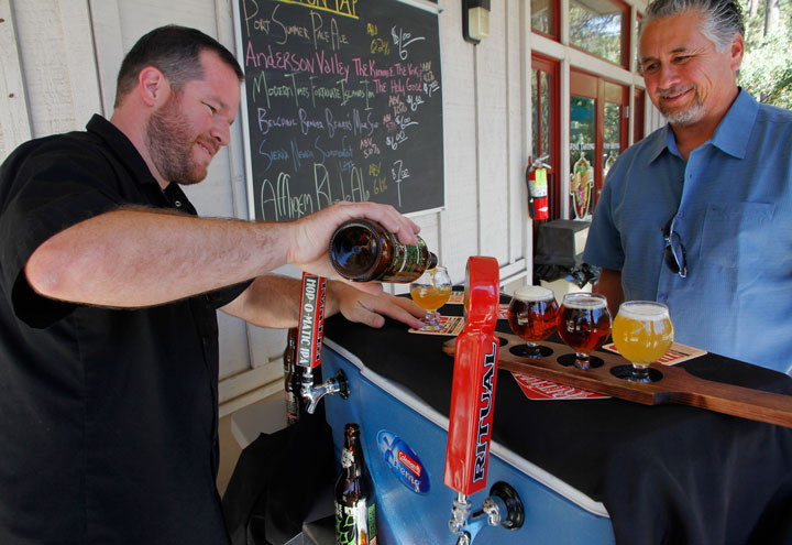 David Brigham pours a West Coast IPA to accompany Art Serrano's tasting flight, which included two red ales, all from Ritual Brewing Co. of Redlands. Idyll Awhile Wine Shoppe Bistro hosted the beer tasting last Sunday and Ritual Brewing brought the suds.         Photo by John Drake