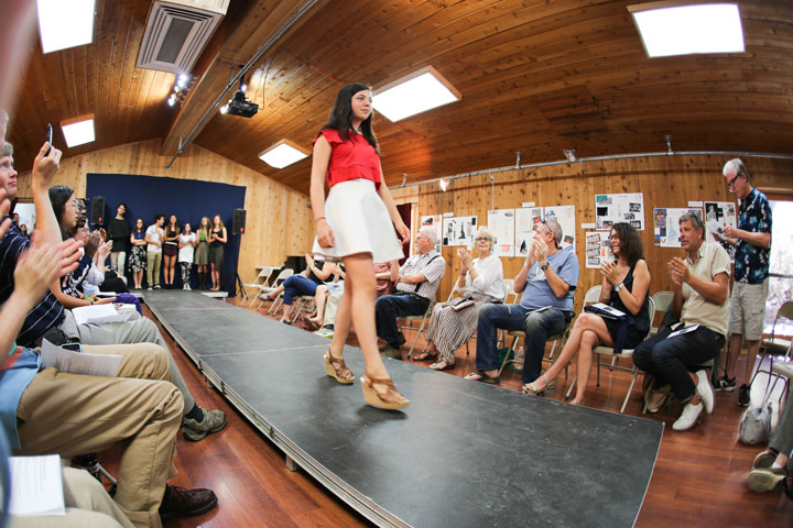 Fashion Show:  The Idyllwild Arts Summer Program included a youth fashion design class and concluded Saturday with a fashion show. Here, Zoe Neuschatz displays her red lycra top and white twill circle skirt. Photo by Cheryl Basye