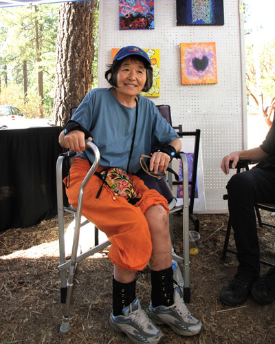 ART THERAPY: Artist Hiroko Momii on the mend at the 2nd Saturday Art Fair presented by the Art Alliance of Idyllwild. Momii was attending a fundraiser, which the AAI held to raise money for the costs of her recovery after a severe traffic collision last May. Photo by John Drake