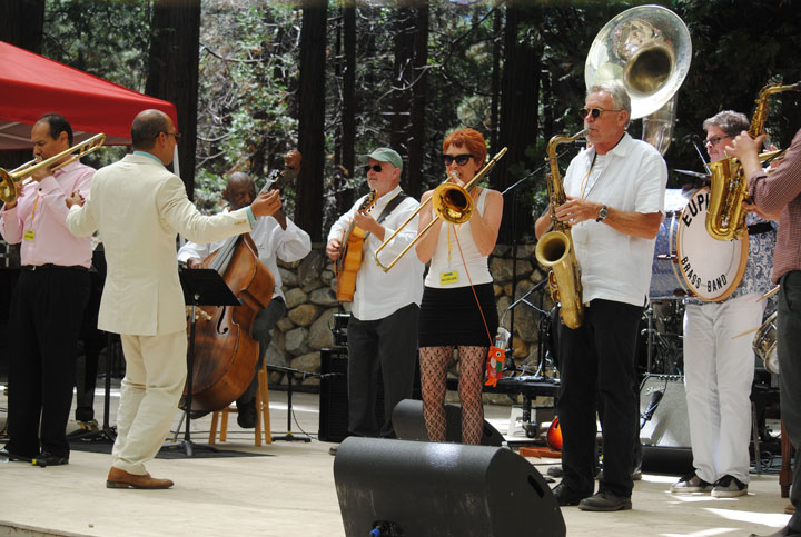 The Euphoria Brass Band surprised Evan Christopher (second from left) when they paraded down the Holmes Amphitheatre as Christopher and other Idyllwild Arts alumni finished their performance Saturday afternoon. Jason Jackson (left) is on trombone, Henry Franklin on bass, and Bob Boss is on guitar and The Euphoria Brass Band members are on the right.           Photo by J.P. Crumrine