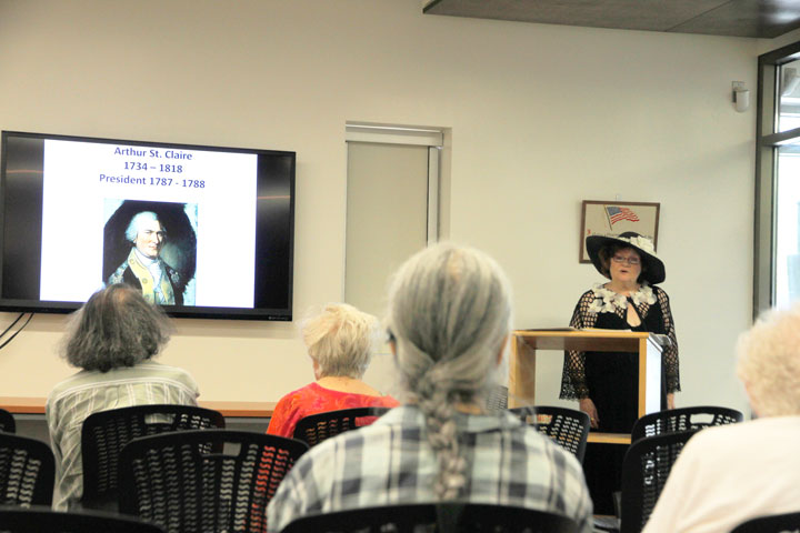 """Penelope Engard engages at another of her historical """"Spoken Words"""" lectures sponsored by the Friends of the Idyllwild Library and held monthly as part of its free lecture series. Engard spoke last Monday about the """"Ten Presidents before Washington"""" — men who ran 15 years of government before the Constitution was ratified and our first president was elected.  Photo by John Drake"""