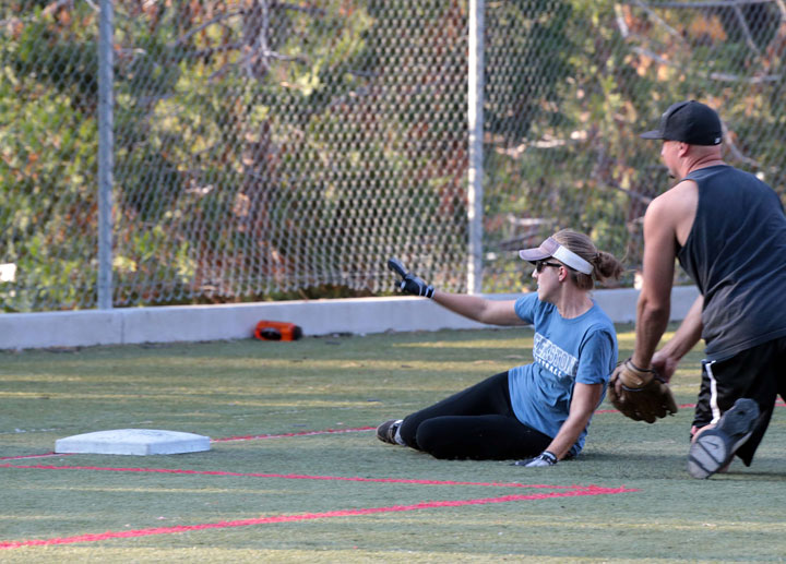 Emily White, playing for Creekstone Inn, slides safely into third base Wednesday while playing adult coed softball against Forest Lumber.        Photo by Jenny Kirchner