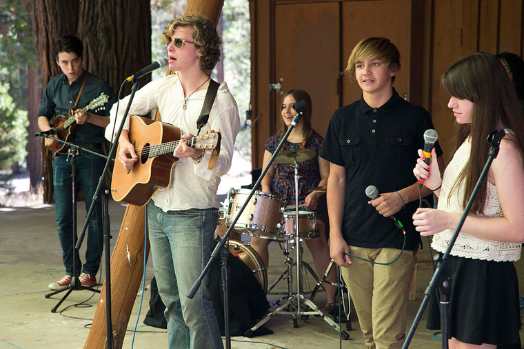 SONGWRITING: While songwriting has been a course at the Idyllwild Arts Academy for a few years, the Summer Program offered its first songwriting session this summer. Here, (from left) are Alec Whiting, Drake Vernoy, Julene Jessel, Julian Caspole and Ann Boyle performing their songs, as well as a couple of cover songs Saturday during the final recital. Photo by Jenny Kirchner