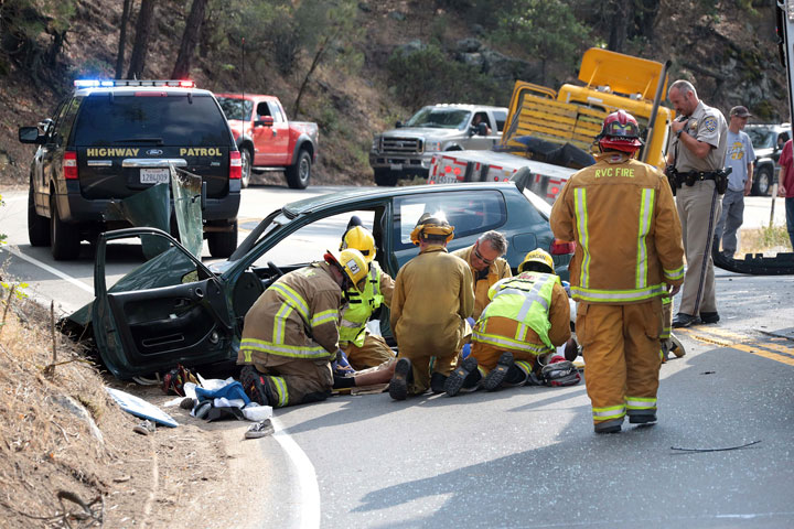 According to CHP Officer Mike Murawski, two males suffered major injuries after losing control of their Honda Civic while traveling at a high speed eastbound on Highway 74 near McCall Park Road Monday around 4:30 p.m. The Honda crossed the double-yellow line, colliding with a Penske truck traveling westbound. Idyllwild Fire transported both men in the Honda to Keenwild Forest Service station where they were transported by Mercy Air to nearby hospitals. The truck driver was uninjured. Idyllwild Fire Chief Patrick Reitz said one man was seriously injured and the other critically.          Photo by Jenny Kirchner