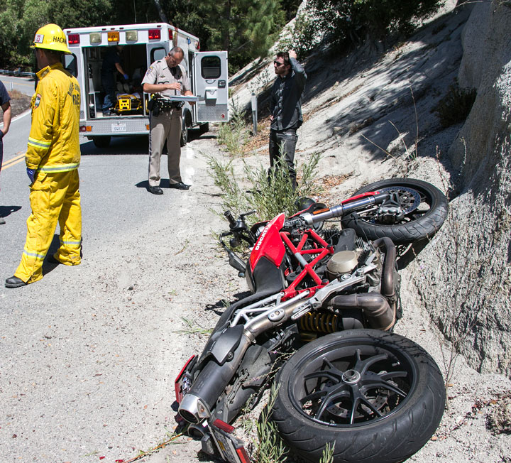 According to California Highway Patrol Officer Mike Murawski, Peter Jackson, 72, (in ambulance) of Rancho Mirage crashed his rented red Ducati motorcycle at about 11 a.m. Friday, Aug. 8 on Highway 243 near Black Mountain Trail. Jackson was traveling southbound when he drove on gravel and lost control. Jackson skidded across the highway coming to rest in the northbound lane. Idyllwild Fire transported Jackson to Desert Regional Medical Center. He had road rash injuries to both knees and hands and his right shoulder.      Photos by Jenny Kirchner