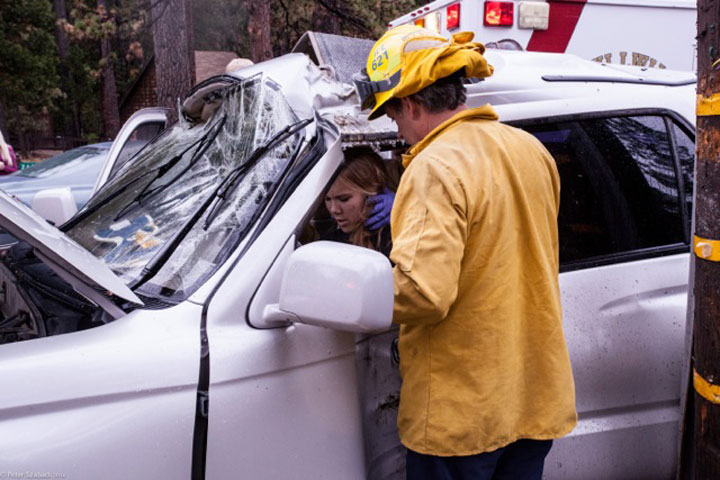 At about 3:40 p.m. Saturday during a rainstorm, Madison Clowdus, 18, of Temecula, lost control of her vehicle and struck a tree and utility pole on Highway 243 just south of Riverside County Playground Road. She had to be cut from her vehicle and was transported to Riverside County Regional Medical Center with non-life-threatening injuries. Photo by Peter Szabadi