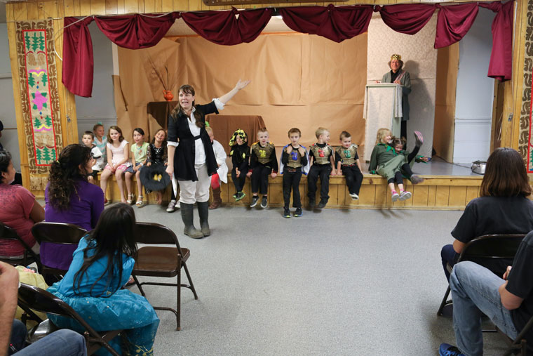 """SUMMER'S END: The theme of the Town Hall Summer Program's evening performance was """"The Castle"""" and the children dressed accordingly. Wendy Watts recognizes the children again as the show concludes. Photo by Cheryl Basye"""