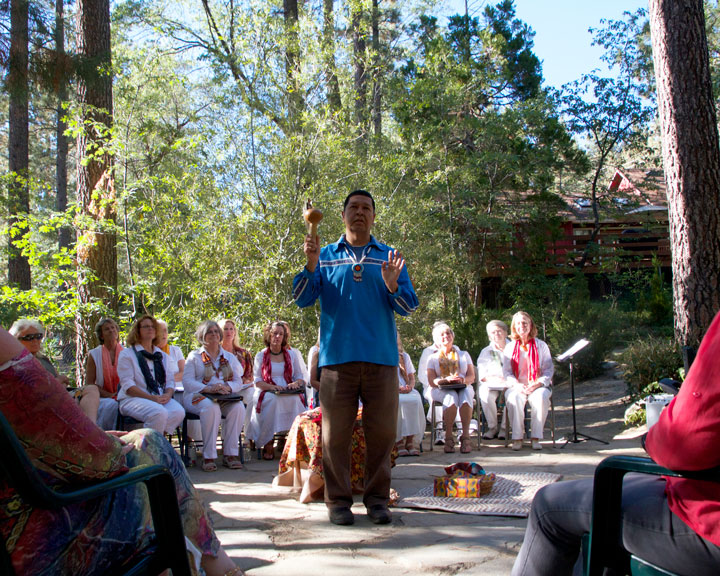 Michael Madrigal leads the ceremony celebrating the Autumnal Equinox in the gardens of Spirit Mountain Retreat. Among the crowd of Idyllwild locals was the featured choral local group Local Color (sitting). Photo by John Drake