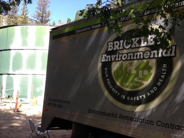 Brickle Environmental oversaw the handling of hazardous materials as Fern Valley Water had Tank no. 5 razed last week. Photo by Steve Erler