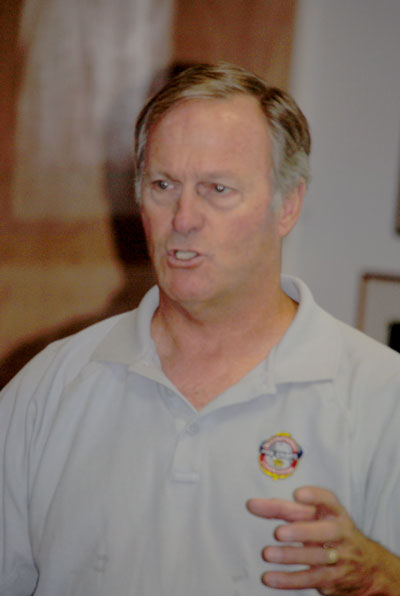 Dave Driscoll, former San Bernardino County fire chief, discusses a cohesive fire management strategy at last week's Mountain Area Safety Taskforce meeting. Photo by J P Crumrine