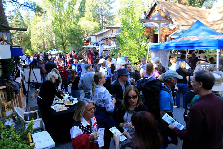 The Art Walk and Wine Tasting is the Art Alliance of Idyllwild's largest fundraising event of the year. This scene was at Oakwood Village last year.      Photo courtesy Art Alliance of Idyllwild