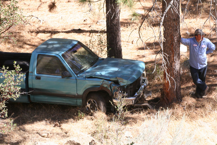 Above, Bob Jackson's pickup went down an embankment Friday morning after sideswiping a car. Photo by Jenny Kirchner