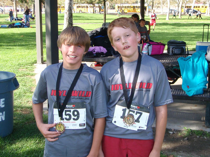 Idyllwild School students (from left) Bryan Mabery and Rene Hernandez participated in the cross-country race North Mountain Invitational at Valley Wide in San Jacinto last week. All of the students did a great job and many medaled, said Office Manager Bethany Swanson. Bryan took first place for the fifth-grade boys division.  Photo by Joe Neu