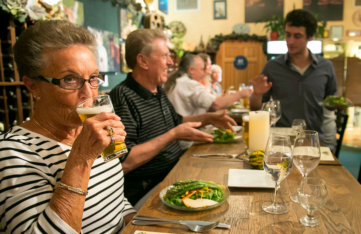 BEER TASTING: At left, part-time Idyllwild residents Gladys and Tom Flanagan enjoy the Octoberfest beer and food pairing Tuesday, Oct. 7, at Idyll Awhile. Pourer and beer expert Jared Dillon is standing.        Photo by Jenny Kirchner